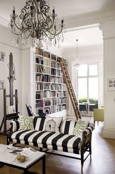 Black and white striped camel back sofa