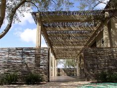 twig pergola with wattle fencing