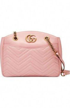 gg marmont matelasse leather shoulder bag by Gucci. Double-G logos inspired  by a design found in the Gucci archives highlight the matelasse-quilted  leather ... 0e740e3c07
