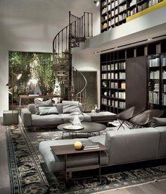 LEMA S.p.A. - Il calore del legno e della pelle abbinato a una palette di grigi rende lo spazio living accogliente ed elegante.