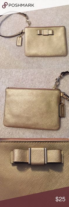 Genuine Coach Wristlet Never worn metallic gold Wristlet. Perfect condition, sad to see it go. Coach Bags Clutches & Wristlets