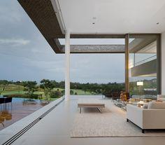 double height ceiling with 20 ft tall sliding pocket glass doors //Casa HS | Arthur Casas