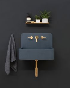 Introducing Elm from the new Kast Canvas range; A contemporary take on a traditional style bucket sink. The pin stripe pattern enhances the vertical form and wraps around the curves. Pictured here with brass fixtures against a dark navy interior.