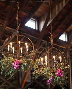Swap out traditional chandeliers for rustic iron orb lights.