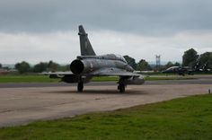 French Armée de l'Air Dassault Mirage 2000N taxies out behind RAF Bae Hawk T1s during Exercise Joint Warrior 13-2.