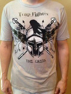 """http://www.trap-fighter.com/  Mike """"The Greek"""" Bronzoulis has risen to the highest ranks in the mixed martial arts world. This shirt celebrates his dedication and ascension. Support Mike and his training by purchasing his walk in shirt. A portion of all proceeds from the sale of the Trap Fighter """"The Greek"""" T-Shirt will go towards Mike's training."""