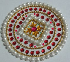 It's  a Kundan Rangoli made of colorful beads and perl, which can be displayed on special occasions like festivals to decorate the floor.  its a set of  7 pieces (6 Square +1 Round) which are made of OHP sheets with kundan beads and can be decorated in different manners.