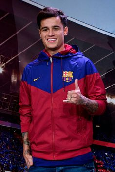 77398035921 Barcelona s new Brazilian midfielder Philippe Coutinho poses for a.
