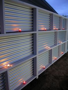 Privacy Fence made from wood and corrugated metal.  Do it double pannel, and punch holes in the metal to create a warmer welcome to the neighbors.