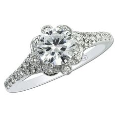 Gottlieb & Sons 29661 - Vintage inspired split shank bead and bezel set floral halo engagement ring with milgrain edges, shared split prong set diamonds, and filigree in the gallery. Beautiful shared split prong set diamond wedding band will fit perfectly next to the engagement ring.