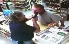 This robber probably wishes he walked into another store. The robber enters the store and tries to pull out his gun.