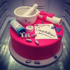 Pharmacist graduation cake with glittery pills, mortar and pestle, pill bottle and diploma. By Donna Belle Desserts michelle@donnabelledesserts.com