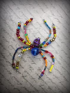 Items similar to Day of the Dead Skull Spider Ornament Suncatcher on Etsy Beaded Spiders, Day Of The Dead Skull, Beaded Animals, Beaded Ornaments, Suncatchers, Fancy, Retail Therapy, Beads, Unique Jewelry