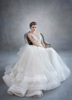 Champagne tulle bridal ball gown, ivory/gold alencon lace shear appliquéd bodice, metallic leaf trim at natural waist, circular tulle skirt accented with lace appliques, hemline finished with horsehair, chapel train. Also available in Ivory/Silver. Style 3607