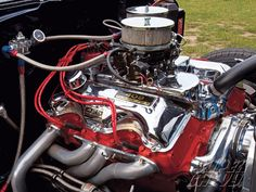 Chevy Big Block 409 w/cross ram intake.. This is a pricey motor!!!!