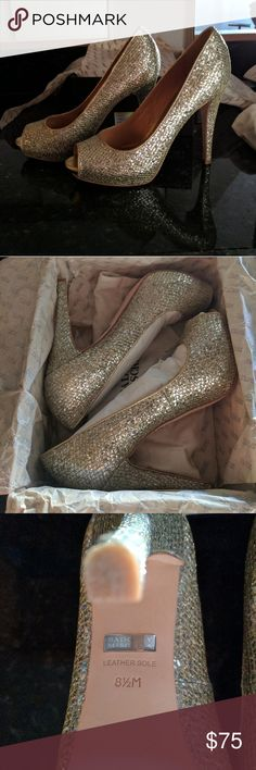 Badgley Mischka Humbie Gold glitter peep toe 8.5 Worn once for a wedding. They come with the box, all the packing papers and the shoe bag. Box and soles show some wear but other than that they are awesome shoes, super fun and beautiful! Badgley Mischka Shoes Heels