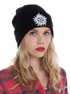 Black knit watchman beanie with embroidered anti-possession symbol on the fold-over.