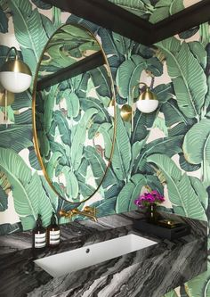 Green and brass. Green bathroom. Brass sconce. Cedar & Moss. Bathroom lighting. Plant wallpaper. Martinique Wallpaper. Bold wallpaper. Modern elegance with approachable elements. LA interiors. Bathroom inspiration.