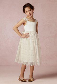 "Brides.com: 20 of the Cutest Flower Girl Dresses  Style 2G6023, ""Belle"" white sleeveless organza and tulle dress with floral corded appliqués, $1,095, Oscar de la RentaPhoto: Courtesy of Oscar de la Renta"