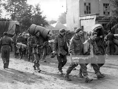 Survivors of the Battle of Arnhem, reach the relative safety of Belgium.10,000 British servicemen took part in the engagement, but only a quarter of them returned.