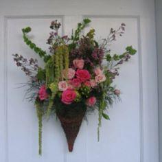 Fresh arrangement in hanging cone. www.markballard.com