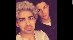 """Nick Jonas, right, <a href=""""https://instagram.com/p/0y8fgWEVaM/?taken-by=nickjonas"""" target=""""_blank"""">posted a selfie</a> of him and his brother Joe -- dressed as """"Grandma Joe"""" -- on Saturday, March 28. Nick Jonas was hosting the Nickelodeon Kids' Choice Awards when his brother made an appearance in drag."""