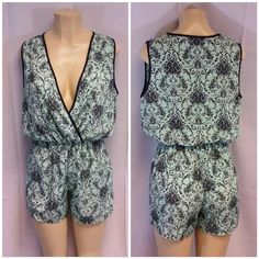 """1 HOUR ONLY SALE!    Mint Green Rompers M Mint Green Rompers with Black Flowers Vines size M, black trim on v-neck and armholes,  v-neck has keyhole opening below the VA to the elastic waist,  gathers at elastic waist, machine washable, soft silky poly rayon blend material,  32"""" length shoulder to hem, bust variable due to v-neck but across back measures 20"""" laying flat YoYo5 Shorts"""