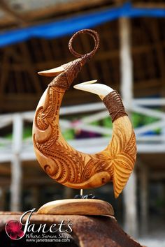 Janet's - Master Hook Standing Carving BRS28, 279.00 AUD (http://www.janetssamoa.com/master-hook-standing-carving-brs28/) Samoan Master Hook Carved from Ifilele Hardwood, Pau Wood and Drift Wood. Trochus Shell finishes the piece. Polynesian Afa (Coconut Husk) Threaded around piece Deeply Set carvings of Samoa Motifs and Tatau Designs.