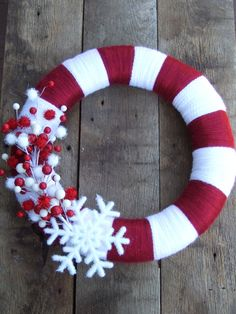 Yarn wrapped candy cane wreath for the front door for Christmas