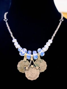 Lovely old kuchi coins hung with glowing faceted opalite rondelles. Loose fit, about 16. *Necklaces can be adjusted slightly to fit any size neck.