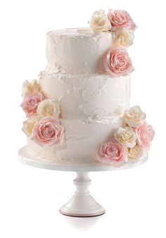 Country flowers cake. Roughly iced in buttercream or royal icing and decorated with fresh, sugar or artificial flowers to compliment your special day.