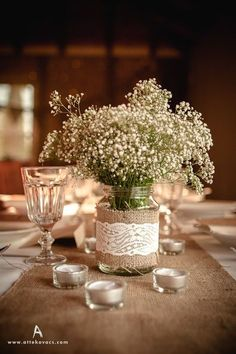 rustic babys breath in marson jar buralp and lace wedding centerpiece / http://www.deerpearlflowers.com/rustic-budget-friendly-gypsophila-babys-breath-wedding-ideas/3/