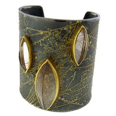 Michael Zobel.  Cuff Silver, Gold, Rutilated Quartz. Bracelet argent, or quartz rutile