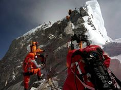 mountaineers walk past the Hillary Step while pushing for the summit of Everest as they climb the south face from Nepal. Dalai Lama, Nepal, Image Designer, Mount Everest, Le Tibet, Digital Cinema, Mountain Pose, Mountain Tattoo, Mountain Range
