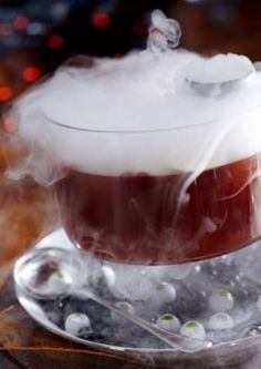 Make alcoholic and non-alcoholic drinks for your guests, and add dry ice for a chilling affect. The ice will keep drinks cold while also creating clouds of smoke that will spill, quite hauntingly, over the edge of cups and punch bowls. Get some Halloween punch recipes at   and tips on how to safely use dry ice in cocktails from .