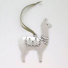 Our llama holiday ornament is decked out in traditional finery to help deck the halls, and spiff up your tree. We think hes quite irresistible! Hand cast in lead free pewter. Comes in a velvet-lined gift box. Three and a half inches tall. Alpacas, Holiday Ornaments, Christmas Decorations, Christmas Crafts, Christmas 2017, Christmas Presents, Llama Alpaca, Alpaca Wool, Choses Cool