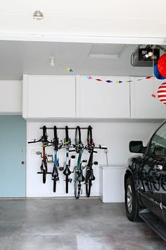 IHeart Organizing: Garage Update: Family Bike Storage The garage is coming along swimmingly and I have been going nook by nook to clean, create zones, organize and label. Last week I shared my . Bike Storage Hooks, Bicycle Storage, Garage Storage, Bike Hooks, Storage Rack, Laundry Storage, Toy Storage, Bike Storage Solutions, Garage Solutions