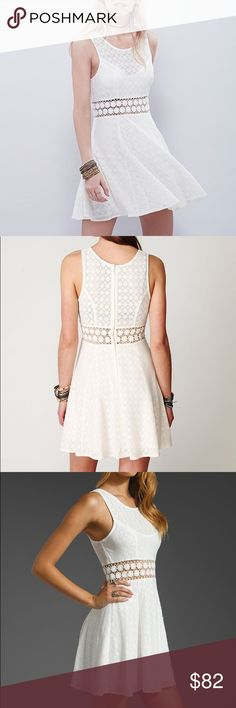 Free People fitted with daisies dress! Size 12 NTW Never worn, new with tags! Free People texturized fit-n-flare tank mini dress with daisy chain crochet cutout detailing around waist. Zips up back. Slip lining. Ivory - Size 12 Free People Dresses
