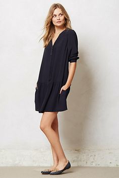 I like the simple loose fitting dress. Comfortable yet can still be dressed up or down.