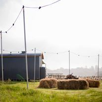 Setting the scene - hay bales, fire pits, festoons for an unforgettable outdoor blessing and reception. Perfect