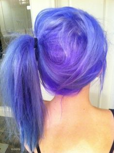 bright purple ponytail- or just being able to pull off crazy colored hair!