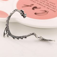 Pin for Later: 29 Items Every True Game of Thrones Enthusiast Should Own  Silver Plated Antique Dragon Ear Cuff (£6)