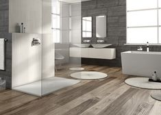 Piatti doccia a filo pavimento per bagni open space