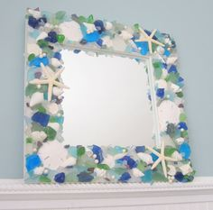 Beach Decor Sea Glass & Seashell Mirror  by beachgrasscottage, ... Or make it myself with my Thrift Store Mirror and a trip to Nautical but nice
