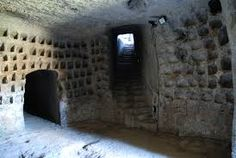 """UNDERGROUND DOVECOTES Underground dovecotes (""""colombaie"""") are widespread in Southern Etruria; these chambers are excavated around the upper edge of tufa plateaus, often near or below existing settlements."""