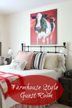 Savvy Southern Style: Updated Farmhouse Style Guest Room, Pottery Barn bedding, H & M pillow covers, French Laundry Home ticking pillow, vintage, quilt, trunk, cow painting, armoire, French market basket, Pottery Barn linen drapes