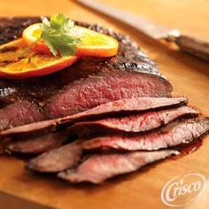 Time to fire up the grill for this Garlic and Herb Grilled Flank Steak from Crisco®.