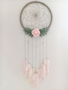 A personal favorite from my Etsy shop https://www.etsy.com/ca/listing/534036973/14-floral-dream-catcher
