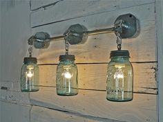 Mason jars can add character to an otherwise bland bathroom by doubling as a light fixture.
