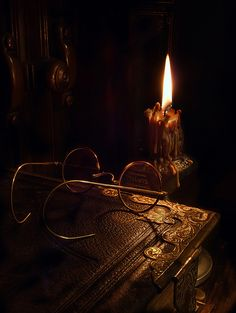 Reading by candle light.